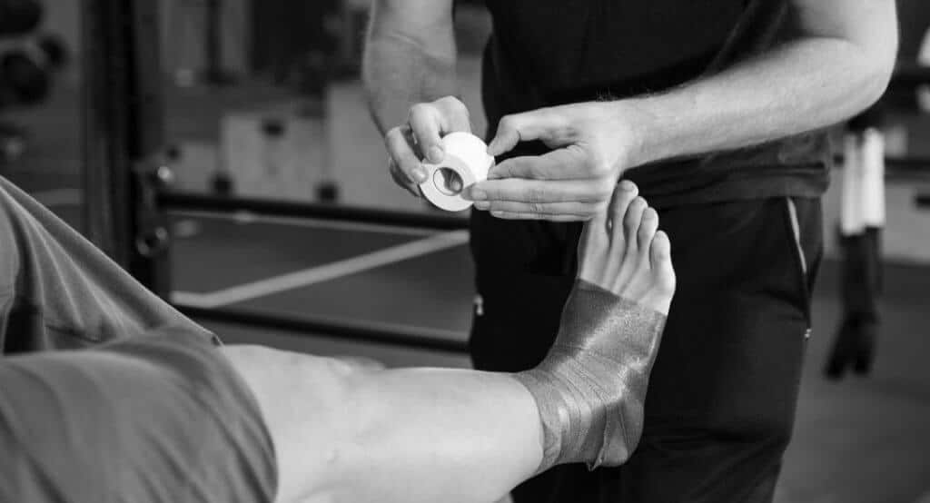 injured athlete ankle wrap