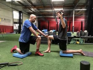 functional sports injury rehab with professional athlete