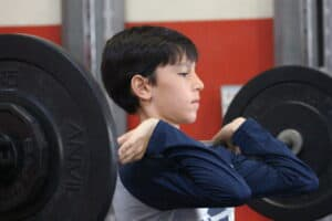 Young Hockey Player Lifting Weights